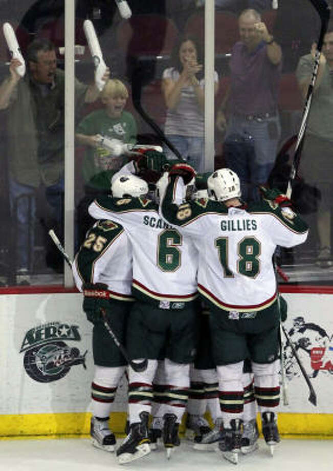 Fans cheer as the Aeros celebrate right wing Jed Ortmeyer's goal in the third period. Photo: Cody Duty, Chronicle