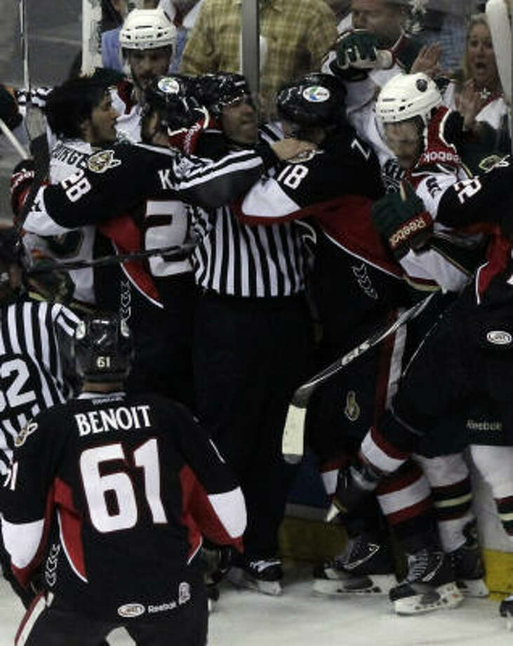 Officials work to break up a fight between the Aeros and the Senators. Photo: Cody Duty, Chronicle