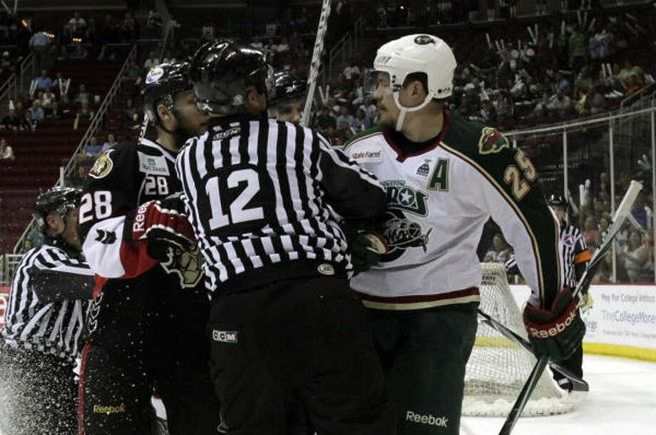 Officials break up a fight between Binghamton Senators right wing Ryan Keller and Aeros center Warren Peters (25) in the first period at the Toyota Center. Photo: Cody Duty, Chronicle