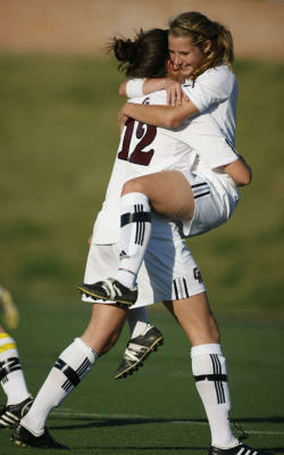 Cinco Ranch player Kayla Anderson, left, gets a celebration hug from teammate Missy Wentz after Anderson's free kick from about 30 yards out gave the Cougars a 1-0 lead on Thursday. Photo: Julio Cortez, Chronicle