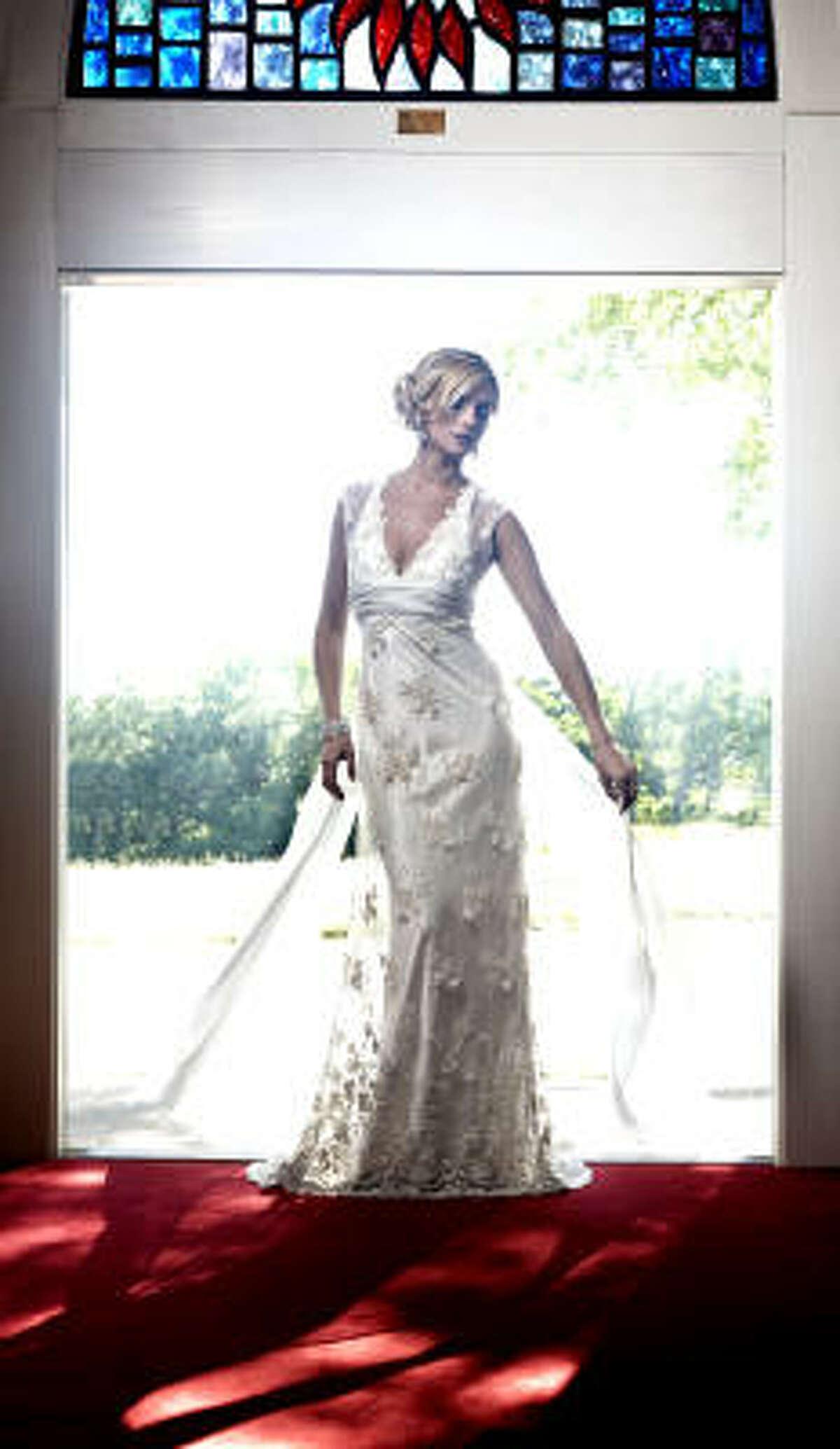 Langer Couture gown, $15,375, and Maria Elena bracelet, and earrings $190, from Joan Pillow A Bridal Salon. Sara Gabriel Vera headband, $136.50, Casa de Novia. Nina shoes, $99, Dillards.