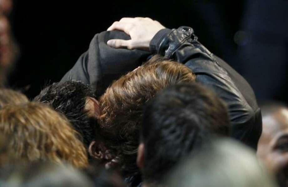 Smooch. Robert Pattinson, right, kisses Taylor Lautner. Photo: Matt Sayles, Associated Press