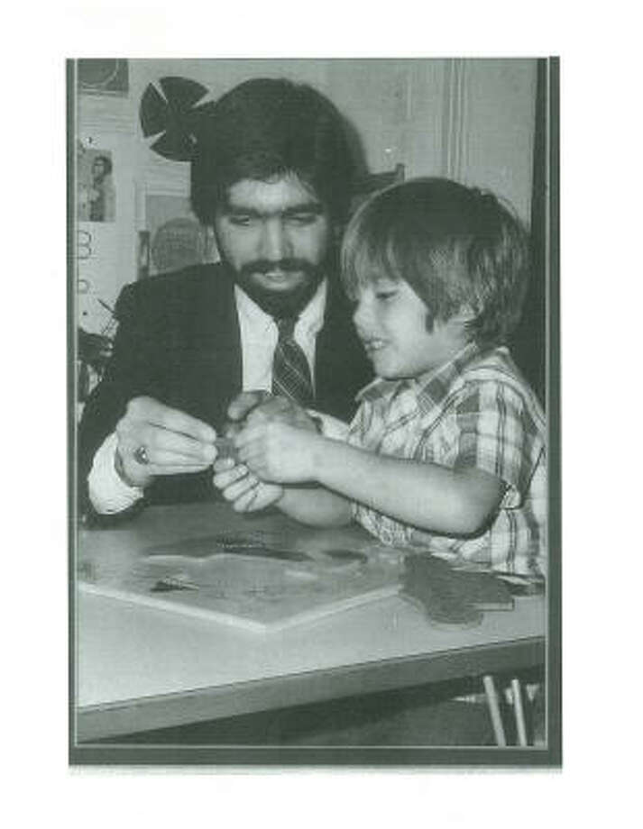 Second Ward resident Jaime Davila, left, with an unidentified child, was among the first in Houston to become involved in a program for low-income preschool-aged children called Head Start. Davila died in 1987 at age 27. The Houston school district memorialized him by naming an elementary school in Pecan Park in his honor. Photo: Davila Family, Contributed Photo