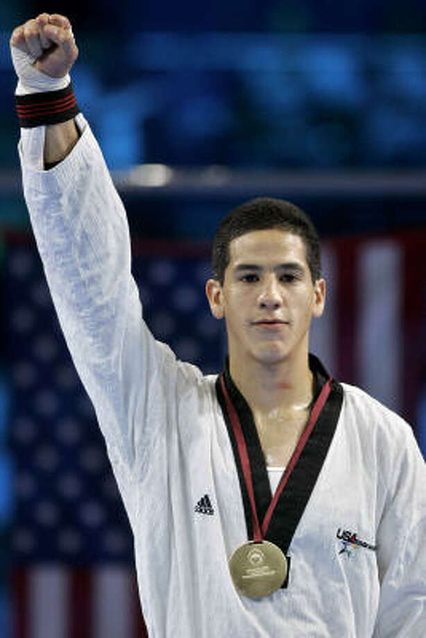 Sugar Land's Mark Lopez qualified for a shot at the 2008 Olympics during the USA Taekwondo team trials in Colorado Springs, Colo. Photo: MANU FERNANDEZ, AP