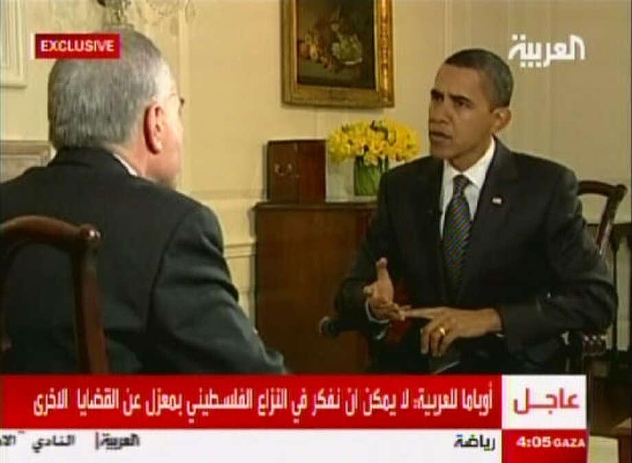 BRIDGING THE GAP: President Barack Obama gives his administration's first formal television interview to the Dubai-based Al-Arabiya cable network Monday in Washington. Photo: AL-ARABIYA, AP