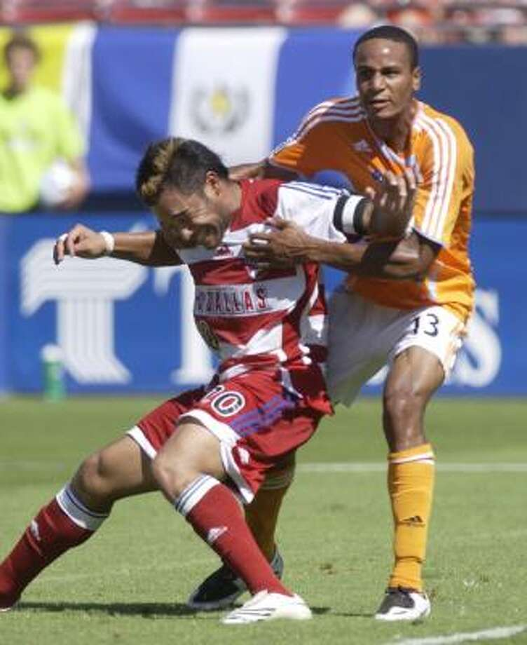 FC Dallas' Carlos Ruiz tries to fight off the Dynamo's Ricardo Clark, right, during a corner kick in the first half of Sunday's game at Frisco. The two players received red cards late in the game when they became tangled up and lashed out at each other, which could jeopardize Clark's availability in the upcoming playoffs. Photo: Juan Garcia, AP