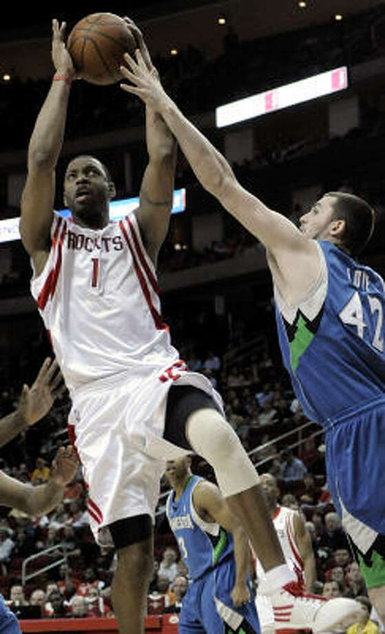 Tracy McGrady (1) looks to get his shot off against Timberwolves forward Kevin Love in the first half. Photo: Pat Sullivan, AP