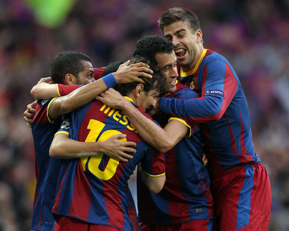 Barcelona's Spanish forward Pedro Rodriguez (hidden) is congratulated by his teammates after scoring the opening goal of the match. Photo: ADRIAN DENNIS, Getty