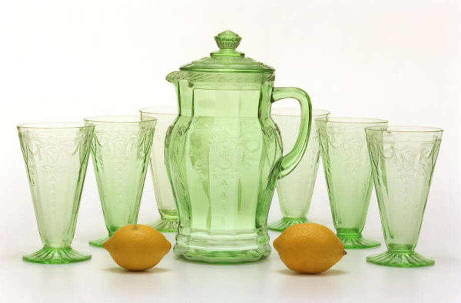 Depression glass pitchers, glasses and kitchen ware will be on display at the annual Festival of Glass and Antique Show and Sale in Rosenberg. This Hocking Glass Co. lemonade set was made in the Cameo pattern. Photo: Buster Dean, Houston Chronicle