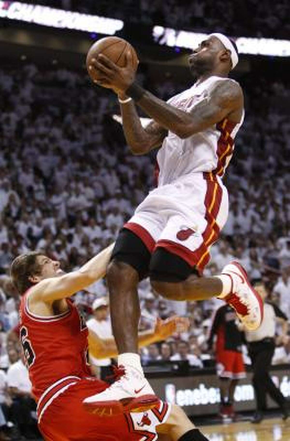 Heat forward LeBron James shoots over Chicago's Kyle Korver during the second half.