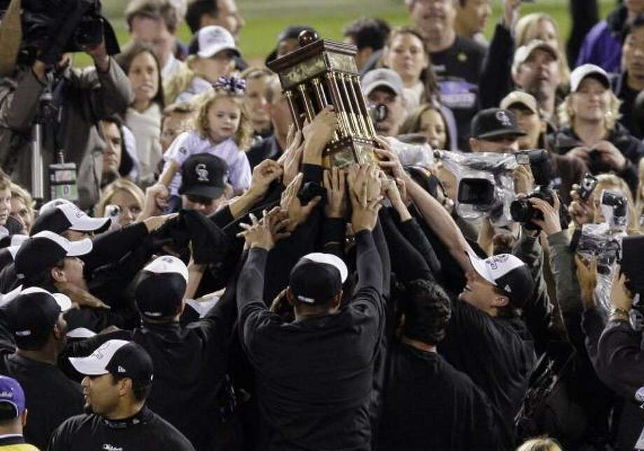 If this scene of the Colorado Rockies celebrating the team's sweep of the Arizona Diamondbacks in the NLCS and berth in the World Series seems unfamiliar, it may be because Comcast switched channel positions for several stations, including TBS at 12:15 Tuesday morning. The switch came during the game. Photo: Eric Gay, ASSOCIATED PRESS