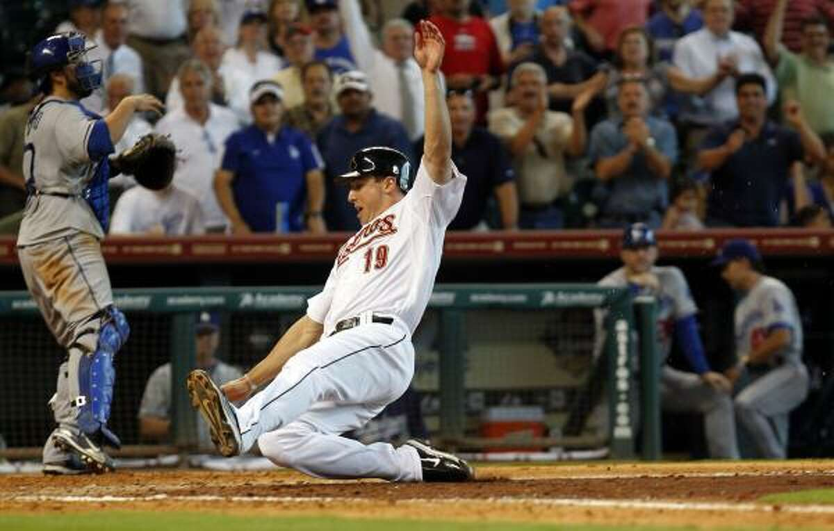 Astros right fielder Brian Bogusevic scores the winning run in the bottom of the ninth inning after a base hit by J.R. Towles.