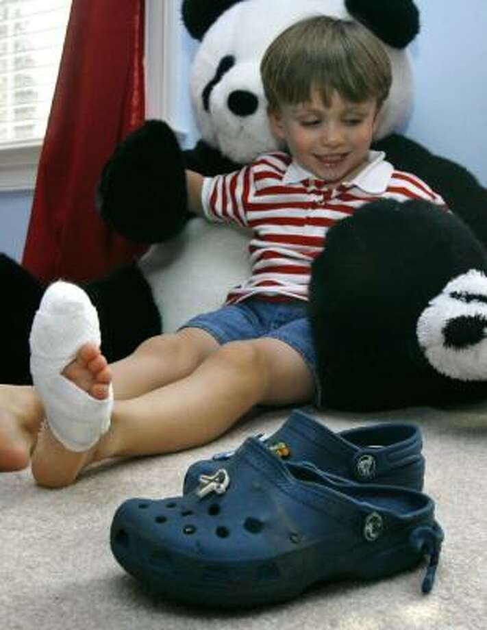 Rory McDermott, 4, injured his big toe when the Croc he was wearing got caught on a mall escalator. Photo: JACQUELYN MARTIN, ASSOCIATED PRESS