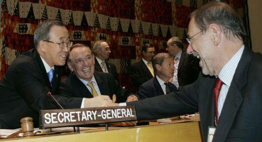 U.N. Secretary-General Ban Ki-moon, left, with Jan Eliasson, center, special envoy for Sudan, greet Javier Solana, right, European Union foreign policy chief, at U.N. headquarters Friday. Photo: DAVID KARP, ASSOCIATED PRESS