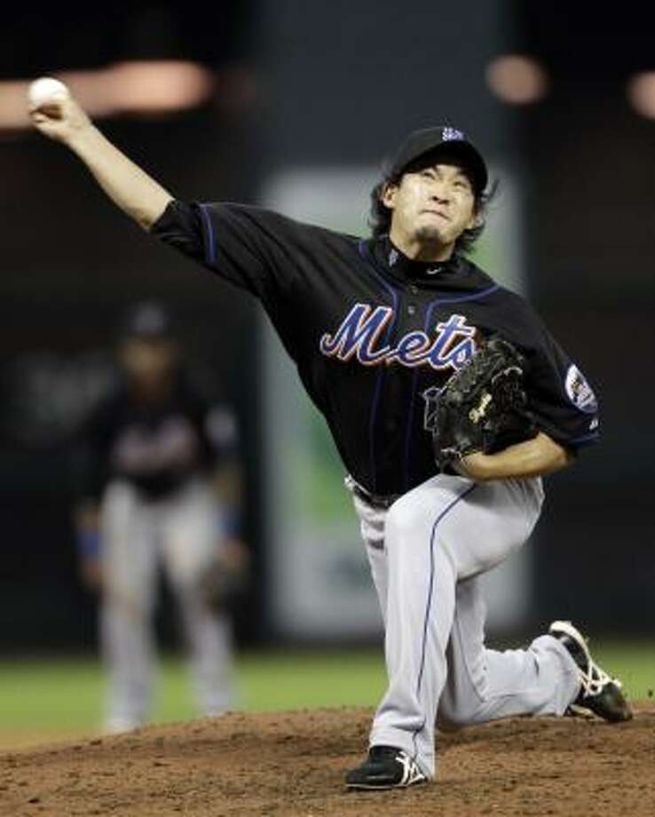 Mets reliever Ryota Igarashi delivers a pitch during the sixth inning. Photo: David J. Phillip, Associated Press