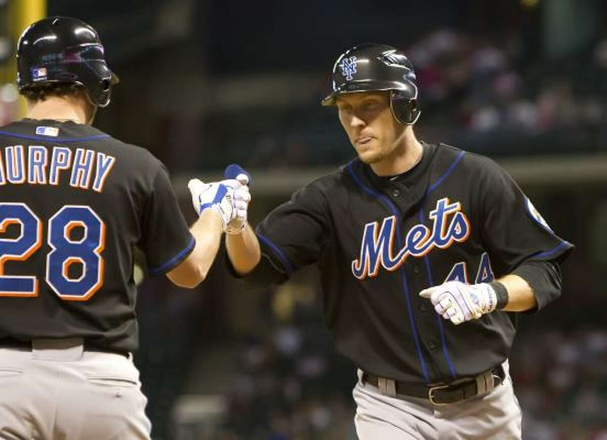 New York's Jason Bay, right, is congratulated by teammate Daniel Murphy after hitting a solo home run in the seventh inning.