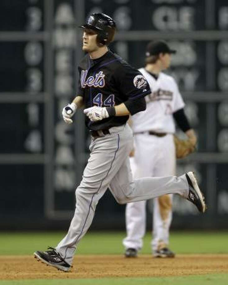 New York's Jason Bay runs the bases after hitting a home run against the Astros during the seventh inning. Photo: David J. Phillip, Associated Press