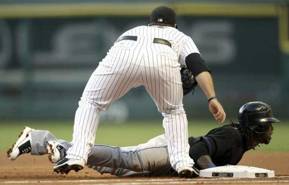 New York's Jose Reyes, right, is tagged out by Astros first baseman Brett Wallace on a pickoff during the first inning. Photo: David J. Phillip, Associated Press