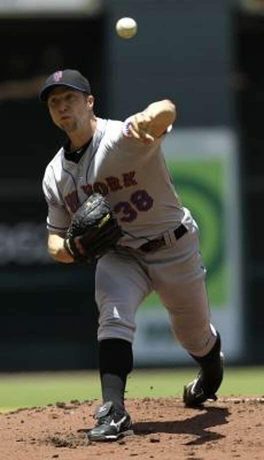 Mets starting pitcher Chris Capuano limited the Astros to two runs in five innings, earning the win. Photo: David J. Phillip, Associated Press