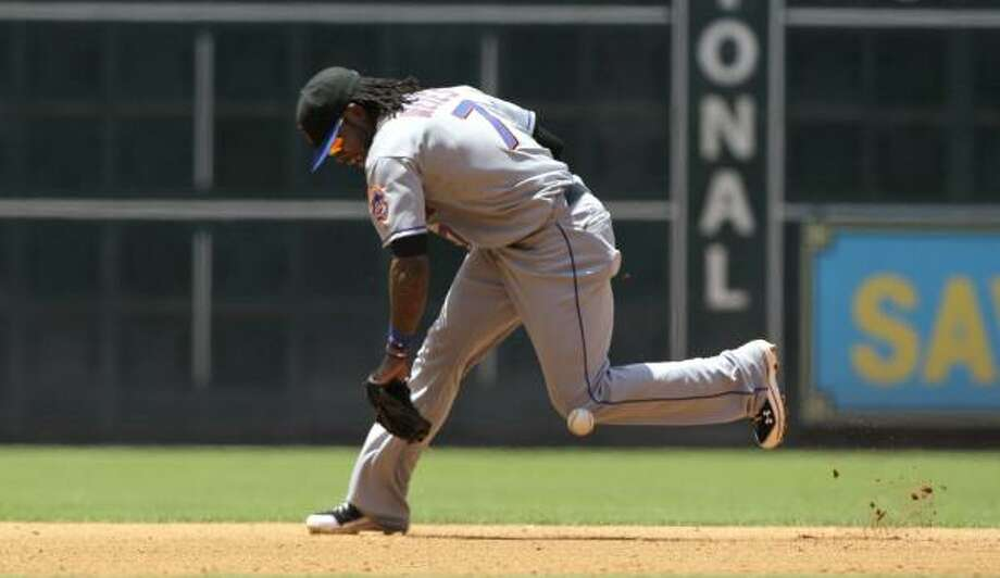 Mets shortstop Jose Reyes tries to field a ground ball hit by Astros second baseman Bill Hall during the fourth inning. Photo: David J. Phillip, Associated Press