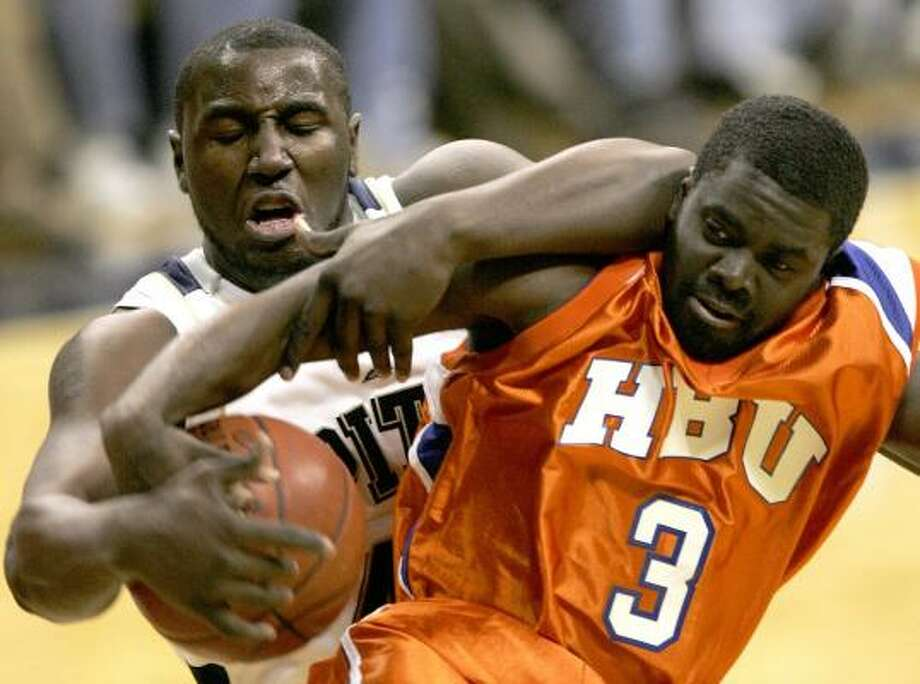 Pittsburgh's DeJuan Blair, left, and Houston Baptist's Sean Morris arm-wrestle for a rebound in the first half of Friday night's game at Pittsburgh. The No. 22 Panthers rolled over the Huskies 103-62. Photo: KEITH SRAKOCIC, ASSOCIATED PRESS