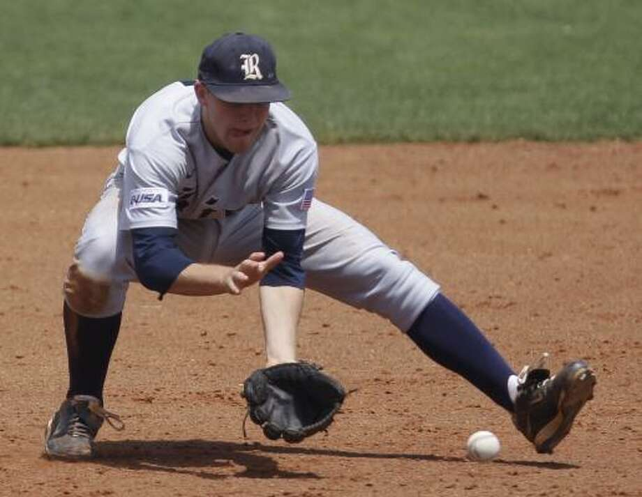 May 8: Rice 5, UH 2  Rice's Derek Hamilton fields a ball hit by UH's Matt Creel before throwing him out at first base during the fourth inning. Photo: Melissa Phillip, Chronicle