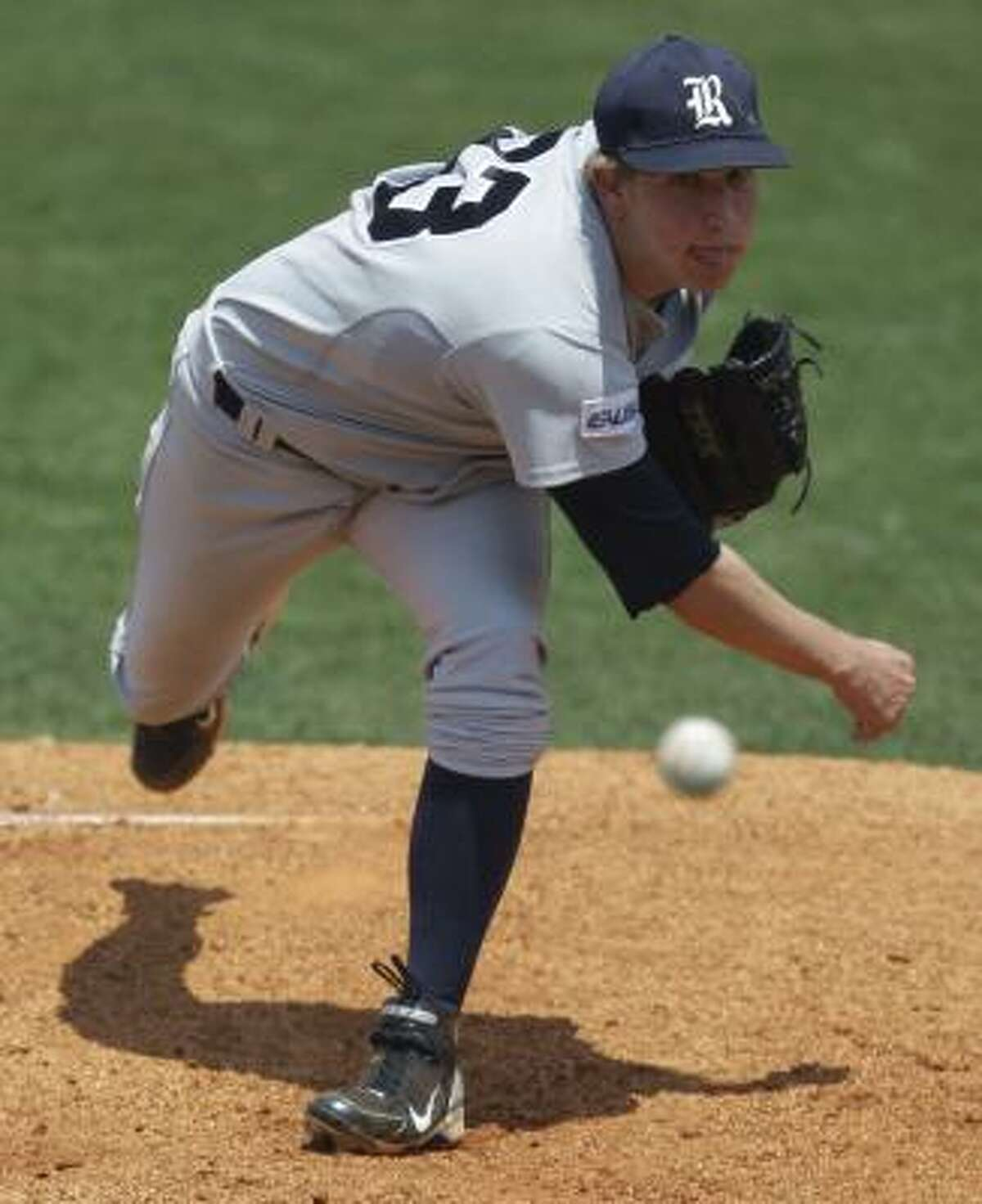 Rice pitcher John Simms follows through on a pitch.
