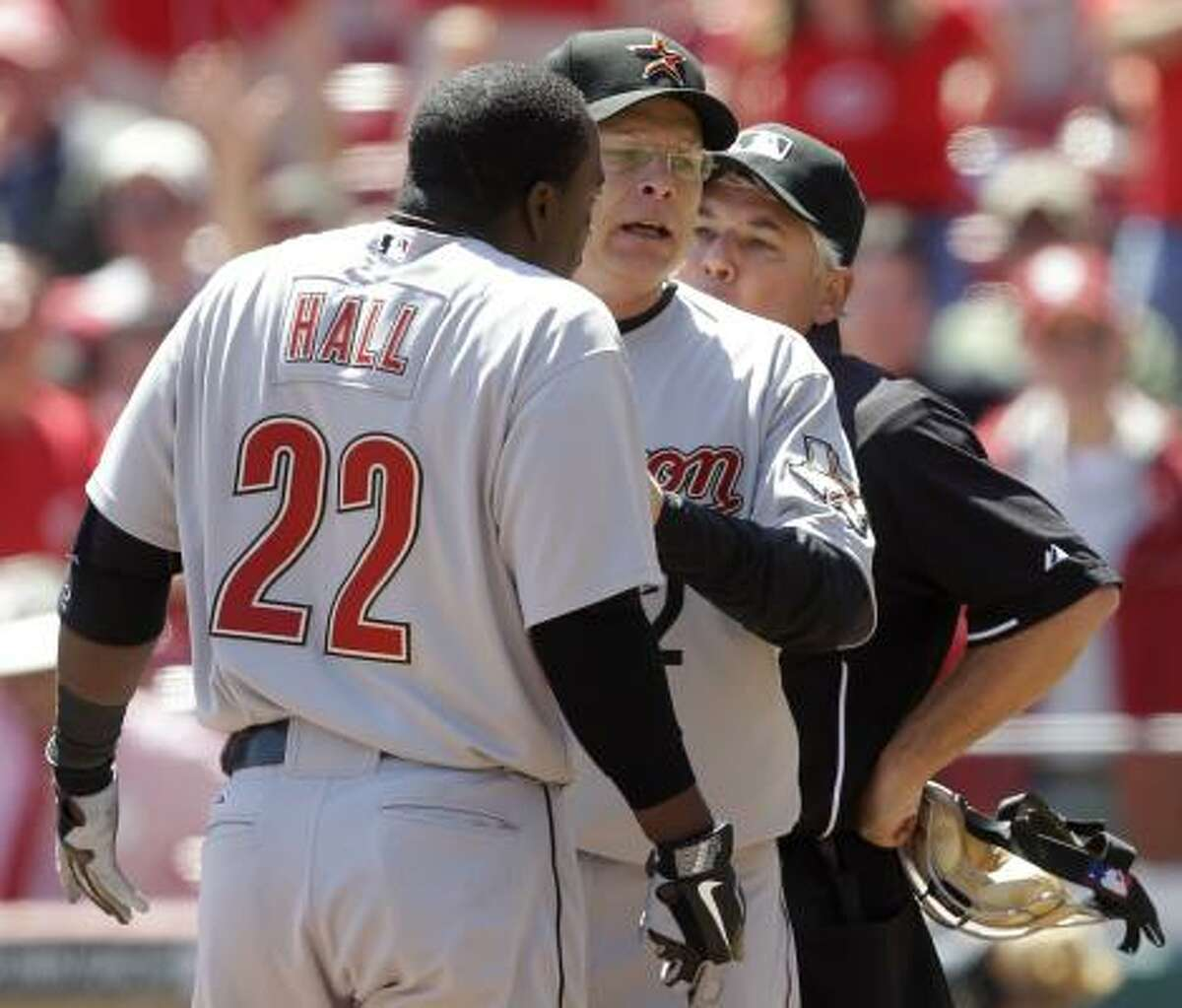 May 5: Reds 10, Astros 4 Astros' manager Brad Mills separates Bill Hall from home plate umpire Tom Hallion after Hallion had ejected Hall for arguing a third strike in the seventh inning on a forgettable day for the Astros. Hall had some choice words about the state of umpiring after the game.