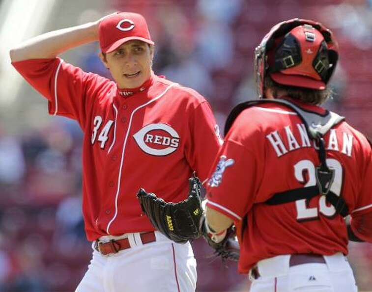 Reds starting pitcher Homer Bailey talks with catcher Ryan Hanigan. Bailey limited the Astros to one
