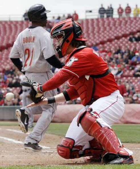 Reds catcher Ryan Hanigan catches the wide throw as the Astros' Michael Bourn scores on a hit by Hun
