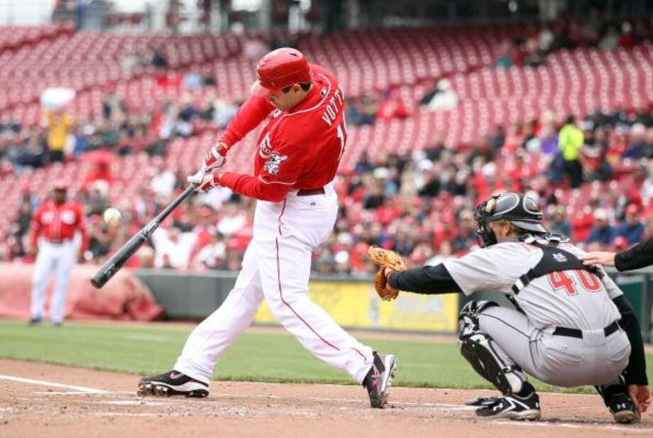 Joey Votto of the Cincinnati Reds swings at a pitch. Photo: Andy Lyons, Getty