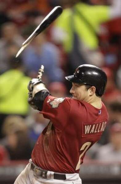 Brett Wallace breaks his bat while lining out to Reds first baseman Joey Votto in the sixth inning.