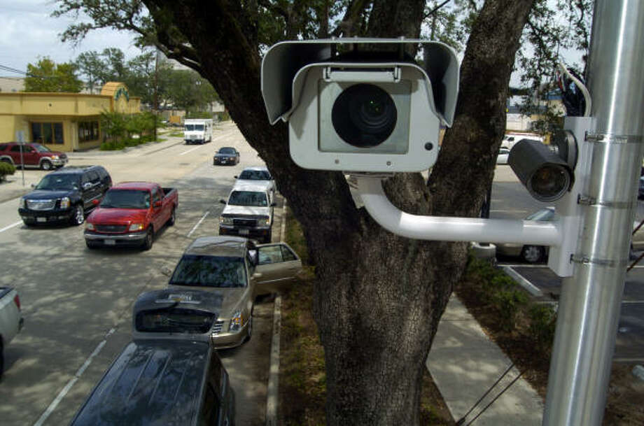 Cameras, such as the one seen here at the intersection of Elgin and Milam, are going up at a third set of locations, mostly on service roads including several on the Southwest Freeway, began photographing violators Saturday. Police plan to install the technology at a total of 50 intersections. Photo: Johnny Hanson, For The Chronicle File