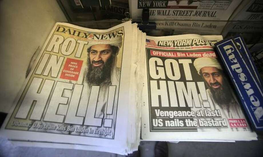 Newspapers announcing the death of accused 9/11 mastermind Osama bin Laden are seen at a newsstand outside the World Trade Center site in New York City. Photo: Mario Tama, Getty