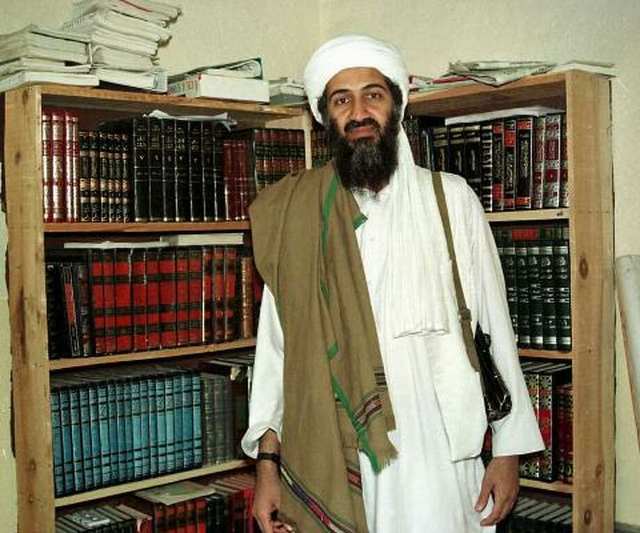 "In Afghanistan, bin Laden surrounded himself with a private army and used his own resources to establish and fund a haven for potential terrorists. He has been in hiding as America's ""public enemy No. 1"" in the region. Photo: Anonymous, AP"