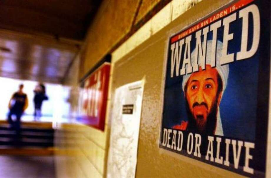 A newspaper cover in the form of an Osama bin Laden wanted poster hangs on a wall Sept. 18, 2001 in a Brooklyn, N.Y. subway station. Bin Laden quickly emerged as the leading suspect in the 9/11 terrorist attacks. Photo: Getty Images