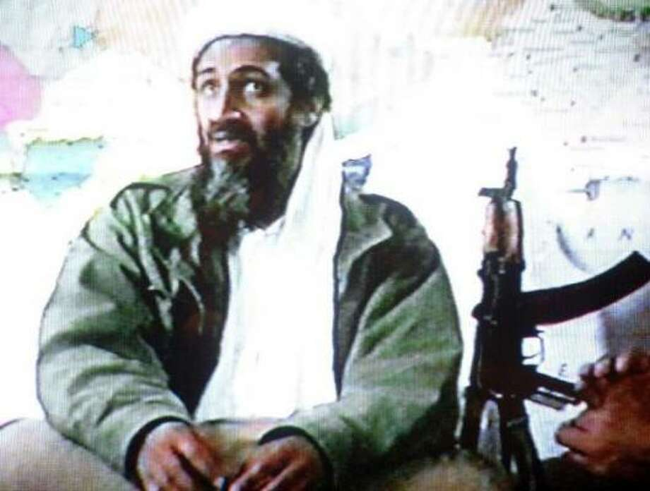"A video grab dated June 19, 2001 shows Saudi dissident Osama bin Laden in a videotape said to have been prepared and released by bin Laden himself. Copies of the tape, which shows members of bin Laden's organization Al-Qaeda, or ""The Base,"" training at their al-Farouq base in Afghanistan, were circulated to a limited number of Islamists. Photo: AFP/Getty Images"