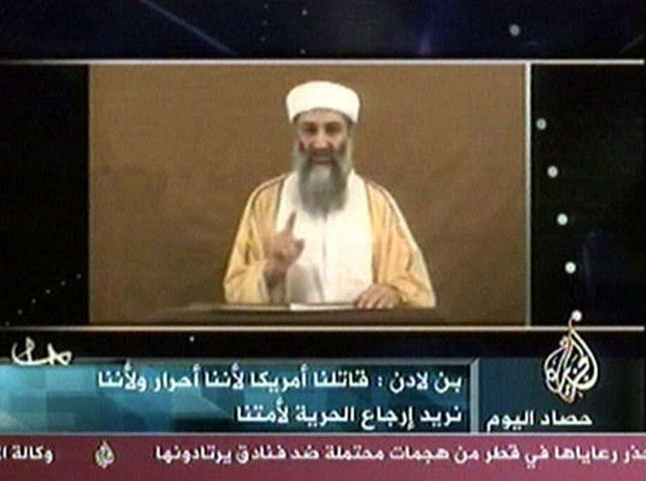 "In this Oct. 29, 2004 image from video, Osama bin Laden speaks in this image made from an undated video broadcast by Al-Jazeera television.  Then Democratic presidential nominee Sen. John Kerry, D-Mass., believes that bin Laden cost him the presidency by issuing a videotape that criticized Bush and warned U.S. voters that ""your security is in your own hands"" in the election. Photo: AP"