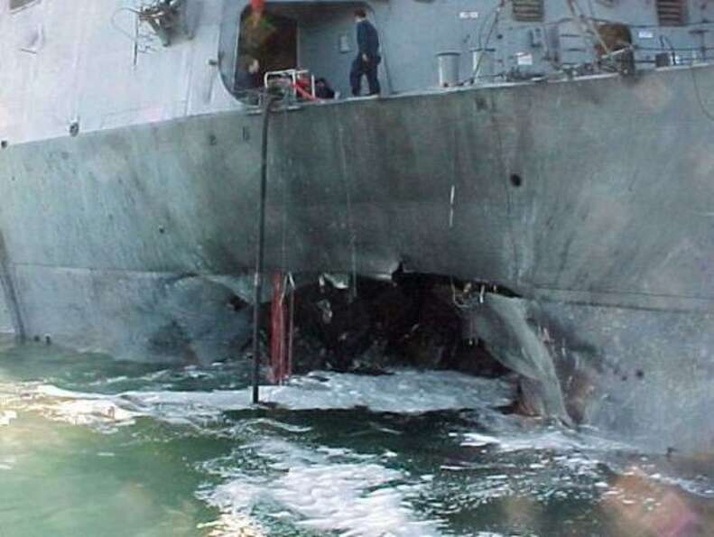 This Oct. 12, 2000 file photo provided by the U.S. Navy shows damage sustained on the USS Cole after