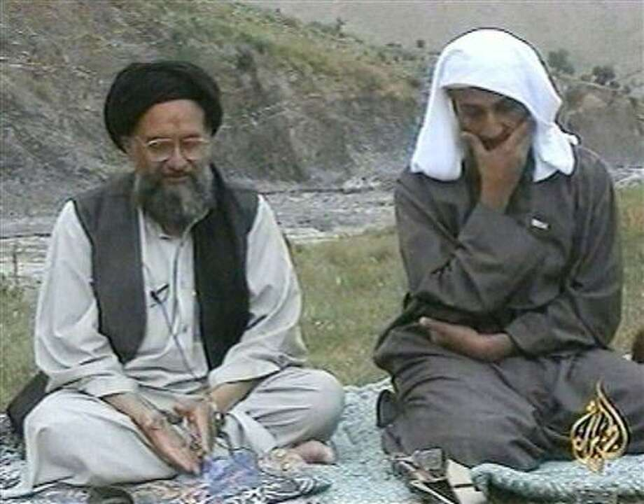 An archive photo shows another appearance by bin Laden on air. His organization, Al-Qaida, has been blamed for the 1998 bombings of two U.S. embassies in Africa that killed 231 people and the 2000 attack on the USS Cole that killed 17 American sailors in Yemen, as well as countless other plots. Photo: Anonymous, AP