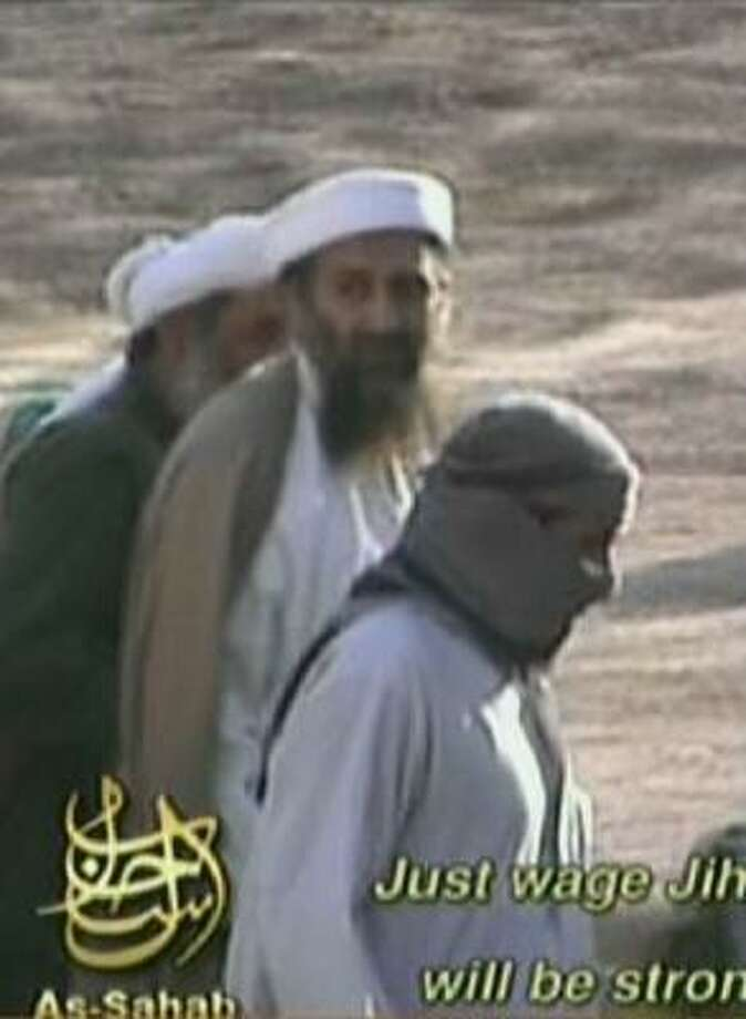 A TV grab taken in September 2006 from a video produced by al-Qaeda-linked media group as-Sahab and broadcast by the Qatar-based al-Jazeera news network shows al-Qaeda leader Osama bin Laden at an undisclosed time and place. The video reportedly showed leaders and members of the al-Qaeda terror group preparing the attacks against the United States. Photo: -, AFP/Getty Images
