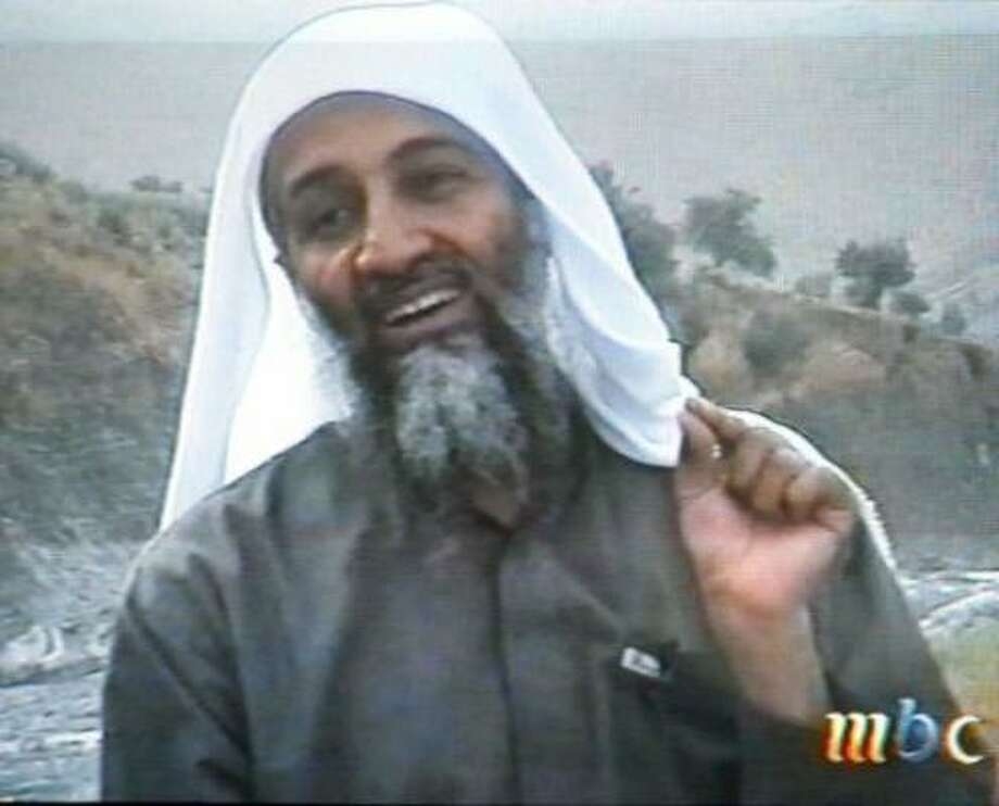 "This frame grab from the Saudi-owned television network MBC (Middle East Broadcasting Center) shows alleged terror mastermind Osama bin Laden. ""God ordered us to terrorize the infidels, and we terrorized the infidels,"" the spokesman of Bin Laden's al-Qaeda network Suleiman Abu Ghaith said in the same tape, claiming the group's responsibility for the September 11 suicide attacks. Photo: AFP / Getty Images"