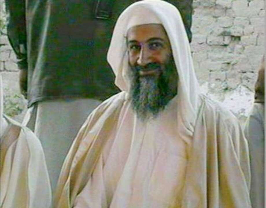 In this file television image broadcast on Qatar's Al-Jazeera TV, is said to show Osama bin Laden, at the wedding of his son in January 2001. Photo: AP