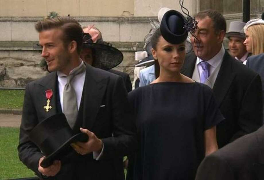 In this image taken from video, soccer star David Beckham, left, and Victoria Beckham arrive at Westminster Abbey for the Royal Wedding. Photo: AP