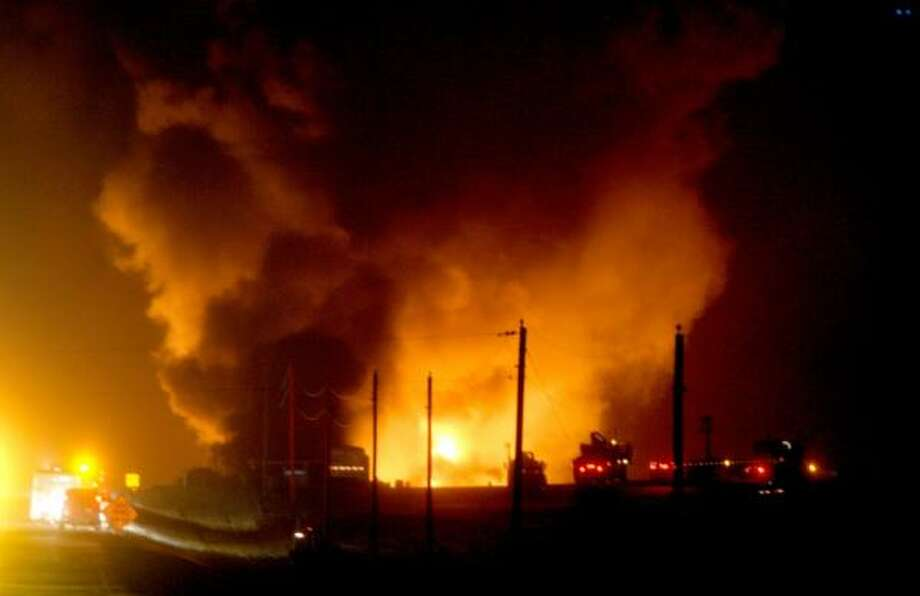 Enbridge Energy Partners' pipeline burns Wednesday night in Clearbrook, Minn. The line carried crude oil imported from Canada. Photo: ERIC HYLDEN, GRAND FORKS HERALD