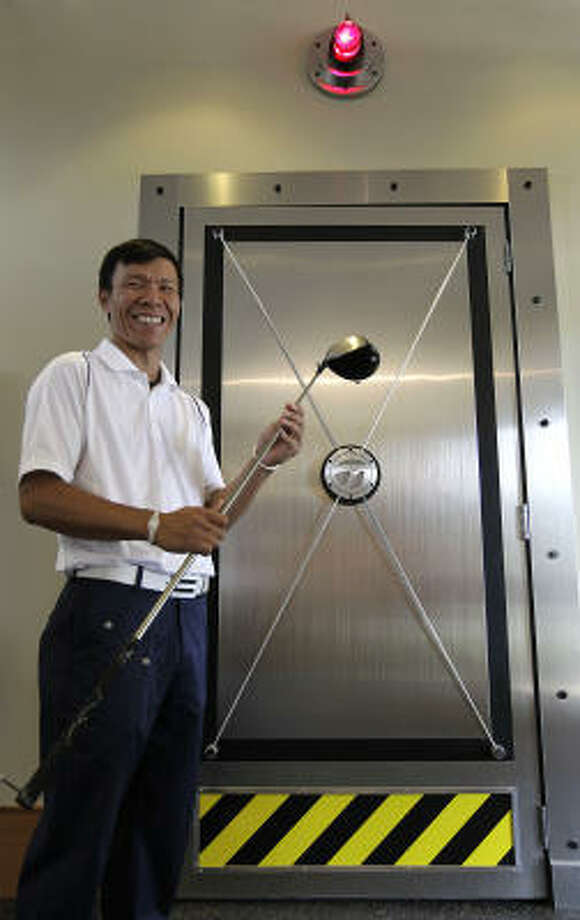 Edwin Fuh, manager at the TaylorMade fitting lab at Redstone Golf Club, stands outside of the vault door of his lab. Photo: Karen Warren, Chronicle