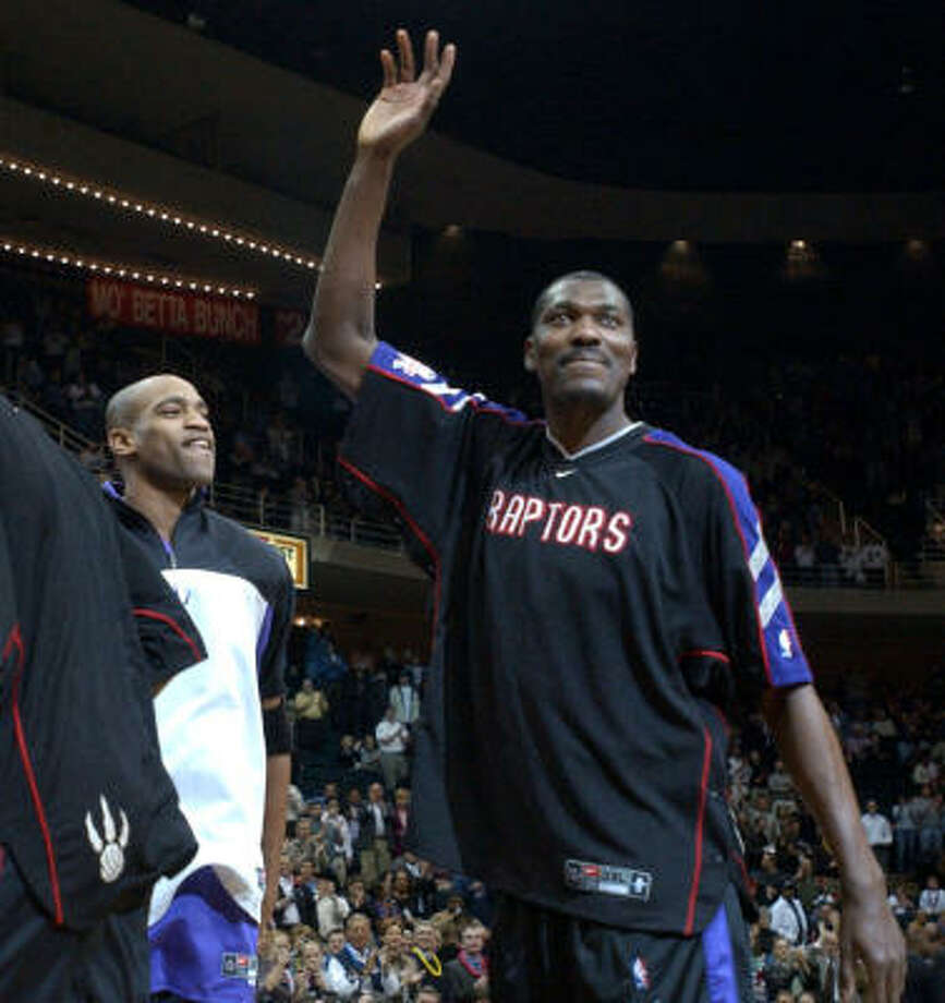 """Hakeem Olajuwon / Rockets to Raptors.  Left via free agency, returned March 5, 2002.Stats : Seven points, seven rebounds in 25 minutes, Rockets won 112-109.Reception : A """"Hakeem the Dream Olajuwon"""" PA introduction followed by a warm one-minute-plus ovation.Reaction : """"I'm glad it's over."""" Photo: Karen Warren, Chronicle"""