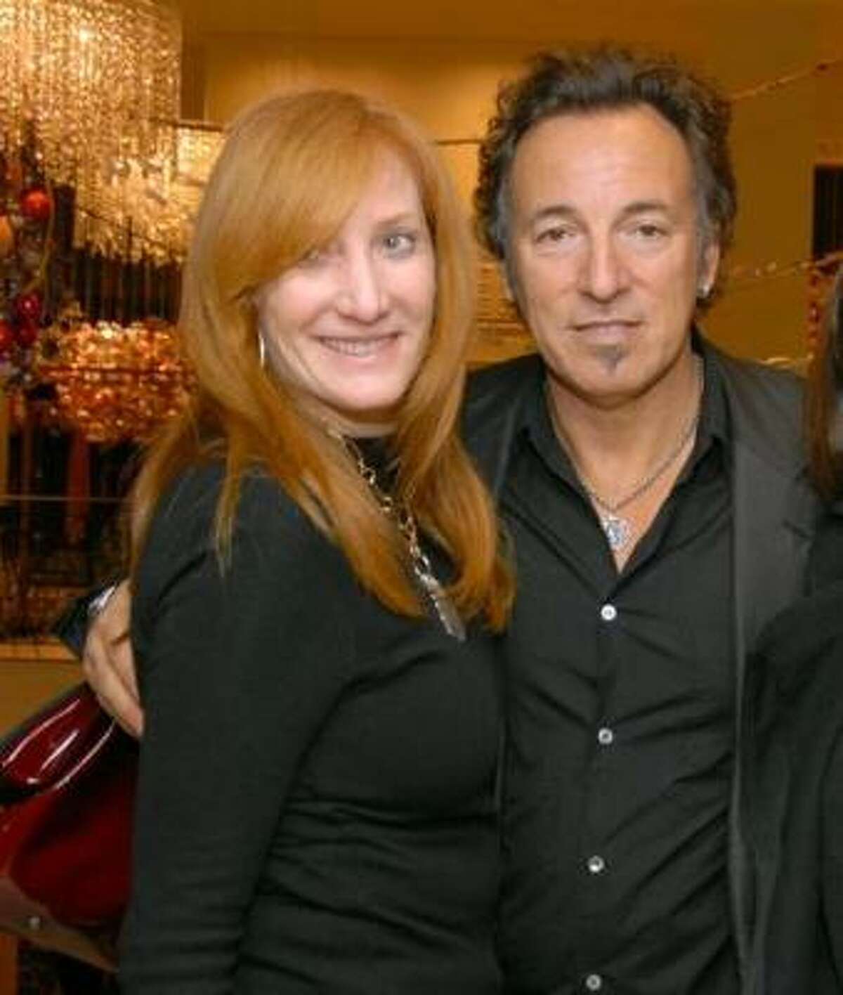 Bruce Springsteen 's three year marriage to Julianne Phillips ended after pictures surfaced of The Boss and E Street band member Patti Scialfa getting cozy on a hotel room balcony.