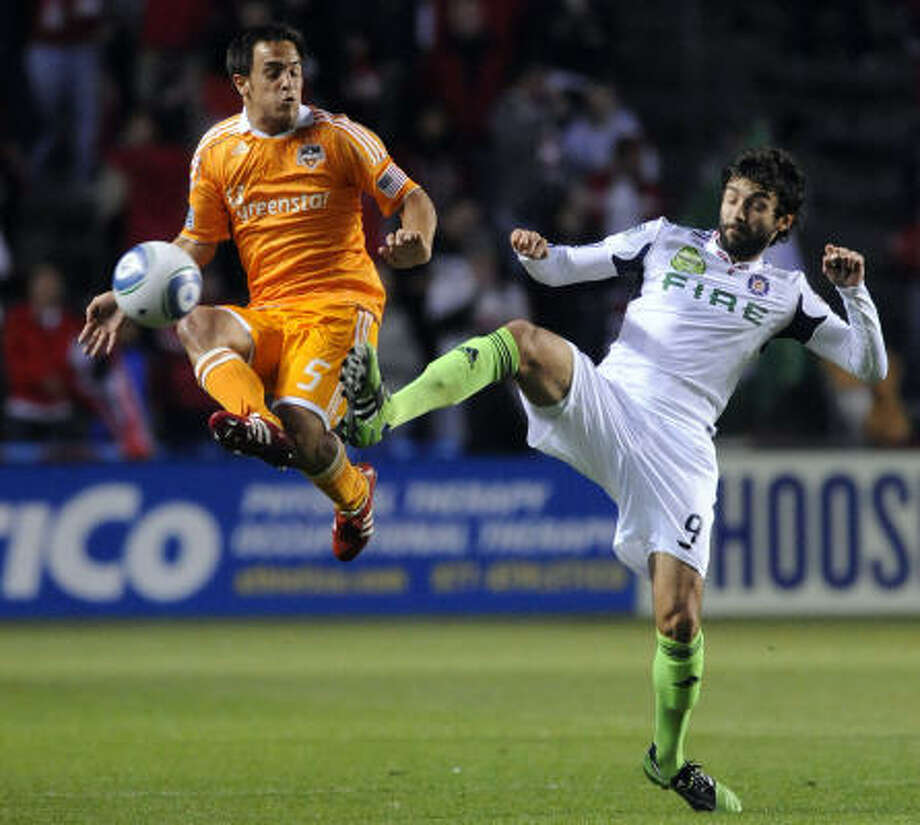 April 23: Dynamo 1, Fire 1 Dynamo midfielder Danny Cruz, left, and Chicago's Baggio Husidic battle for the ball during Saturday's match at Toyota Park in Bridgeview, Ill. Photo: David Banks, Getty Images