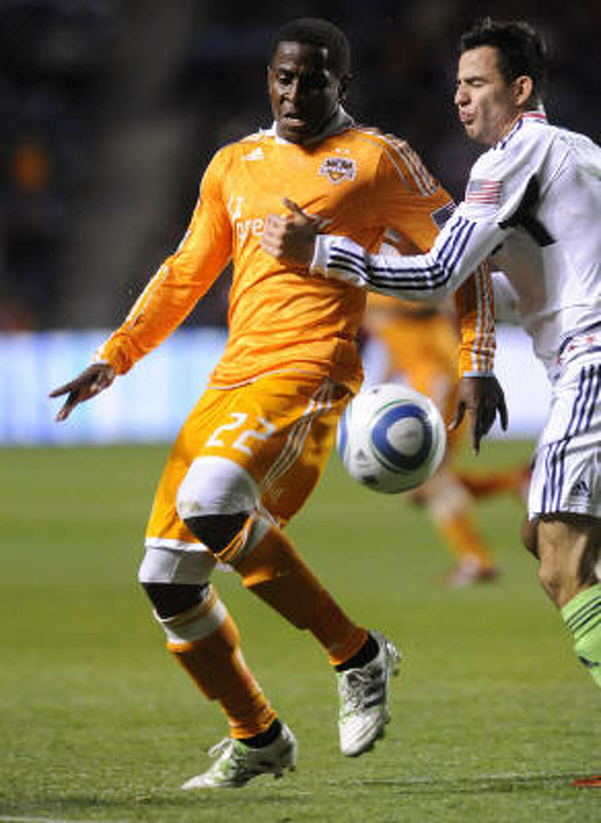Dynamo midfielder Lovel Palmer, left, and Chicago's Marco Pappa try to gain control of the ball.